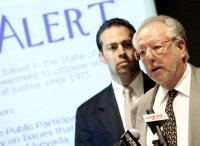 County Commission Chairman Dario Hererra, left, looks on as Mayor Oscar Goodman talks during a news conference at City Hall.